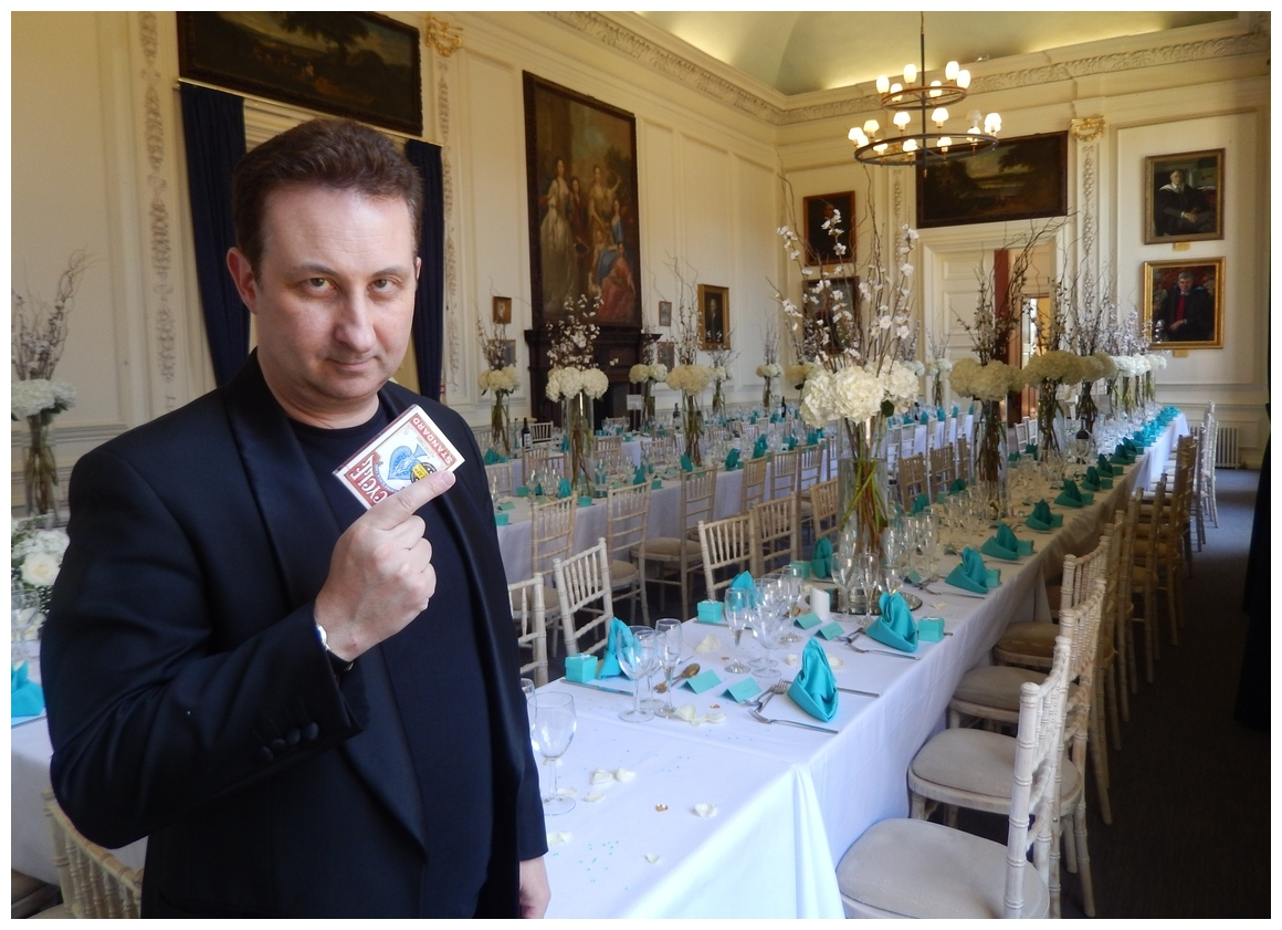 Aberystwyth Magician Gets ready to perform around tables