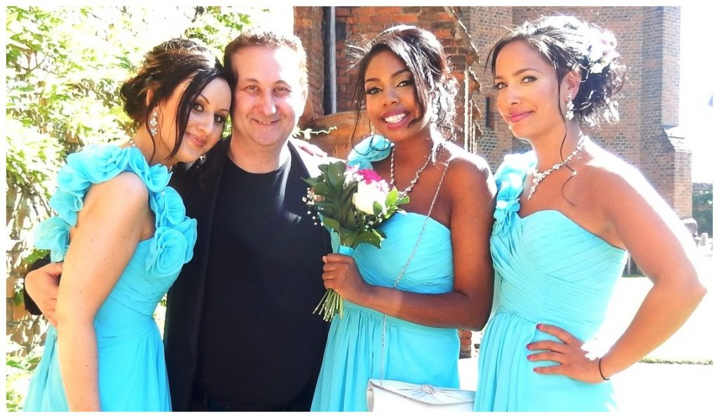 Andy Field hugged by beautiful Bridesmaids.