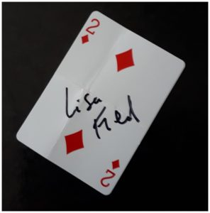 Wedding magician has playing card signed by a guest