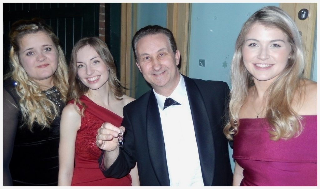 Folkestone corporate magician borrows three rings and links them together.